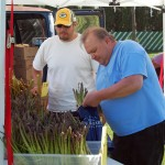 A customer makes a selection of some asparagus as vendor Mike Toboyek (right) looks on. Toboyek of Riverwood Produce Farm had asparagus, rhubarb, honey and other products available at his stand.