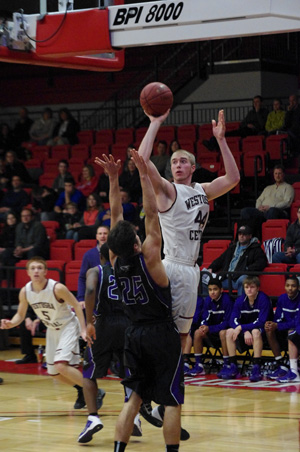 Central's Karsten shoots over Michael Roach. /David Thoss photo
