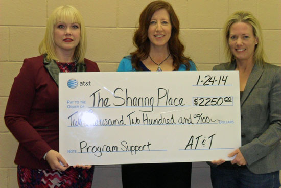 AT&T Wisconsin provided a $2,250 donation to support The Sharing Center's food pantry.  Pictured (L-R) Tricia Conway of AT&T Wisconsin, Sharon Pomaville of The Sharing Center and State Rep. Samantha Kerkman. /Contributed photo