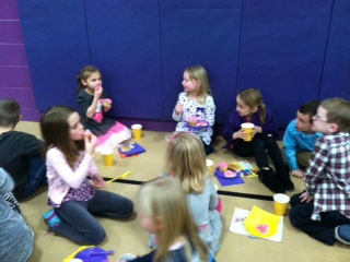 First grade students spend time after the ceremony to talk and eat. /Submitted photo