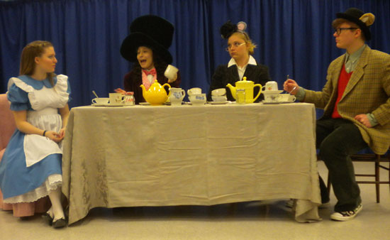 The Mad Hatter poses yet another riddle to Alice as the Dormouse and March Hare listen intently.  Left to right: Hannah Kunce, Raquel Rivas, Destiny Kent and Kyle Racas.  /Submitted photo