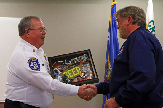 Chief Mike Slover presented Tom with a shadow box commemorating his career created by Lt. Mandy Dodge.