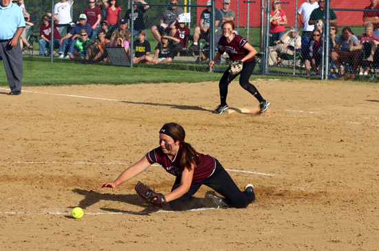 Making the last out. Pitcher Melissa Hrncar retrieves the ball.