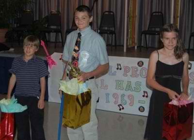2014 Bristol Jr. Outstanding Citizen Seth Bayless (center) with finalist Brandon Gorsuch and Amanda Gorsuch.