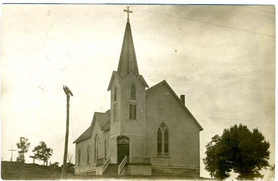 This image is from 1908 and is of Holy Name of Jesus church immediately north of the Cemetery on the hill at Hwy C and B n Wilmot. The clapboard building burned in 1913 presumably started by lightning strike. It was west of the path near the top of the hill to the cemetery. /Contributed photo, used with permission of Western Kenosha County Historical Society