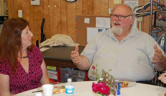 The Sharing Center executive director Sharon Pomaville and center founder Rick Fors.