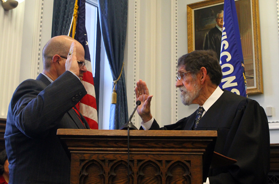 Judge David P. Wilk sworn in by his father Judge S. Michael Wilk.