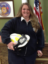 SLFD interi fire Chief Allison Draeger just after being presented her cheif's helmet at Wednesday's Silver Lake Village Board meeting.