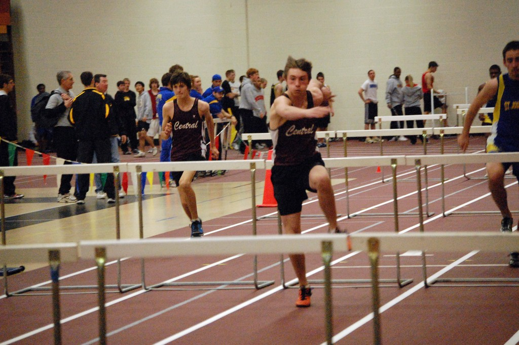 Central sophomore Kyle Mobile, Bristol, (left) and Jason Castona, a freshman from Bristol compete in a 60-yard hurdles heat.