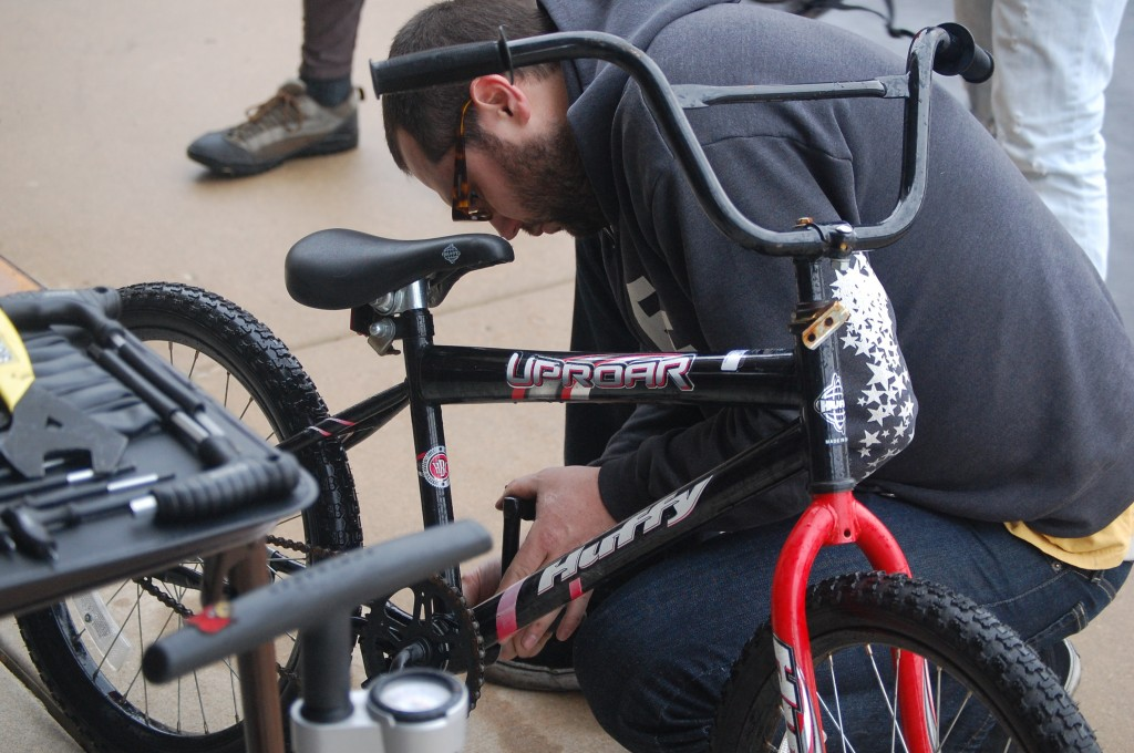 Tony Looney of Southport Rigging tightens up a bike brought to the safety day.