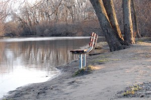 You could still sit on this bench in Fox River Park and not get your feet wet, Wednesday evening.