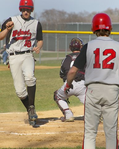 Wilmot's Brendon Hayden scores in front of Chris Laho's tag, Joe Felgenhauer watches the action. Dave Thoss photo