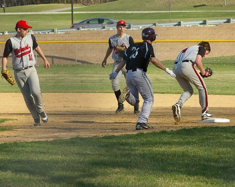 Wilmot's Jay Christian 11, flipped the ball to Qincey Berg to force Tim Clark at first. Dave Thoss photo