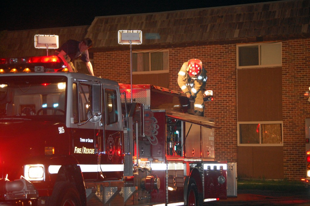 Firefighters secure equipment at the scene of a excessive smoke call Friday evening.