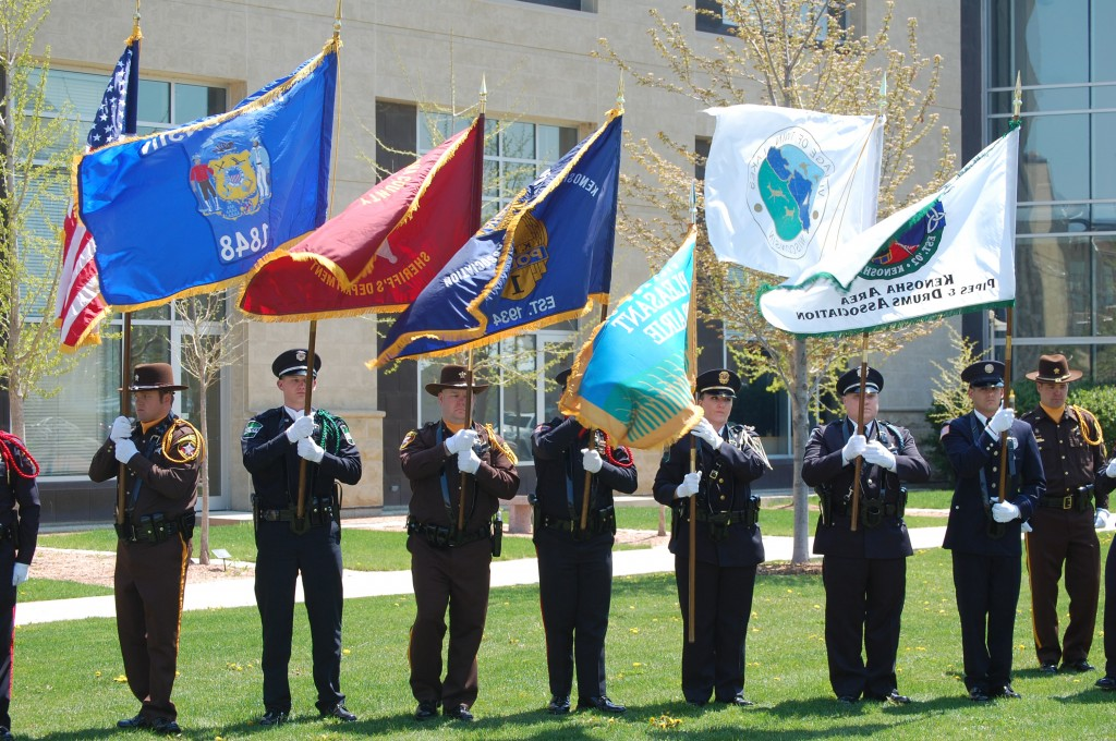 The color guard, made of officers from the Kenosha, Pleasant Prairie, UW-Parkside, Twin Lakes police departments and the Sheriff's Department retire the colors. retires the