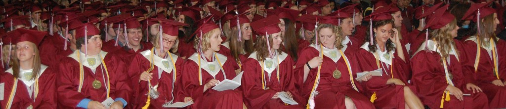 Co-valedictorians (from left) Jessica Hrncar, Allyn Durbin, Catherine Harvey, Dana Sorensen, Lauryn Vanderwerff, Leigh Maltby, Kayla Arbet, Alexandra Zich and Malissa Roberts sit in the front row.