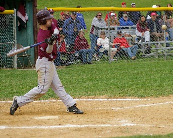 Joe Harms sends a grand slam to right center field. /David Thoss photo