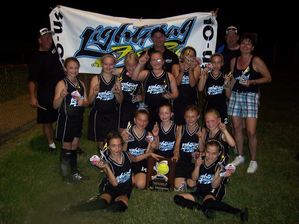 Lightning 10 u team pose with theri trophy: First row - Montana Platts, Katrina Bostanche, Becca Bell, Katie Holstrom, Jaina Westphal, Sydney Grossi. Second Row - Myranda Schuttenhelm, Lauren Brendel, Siera Sieberth, Jordon Kaluzny, Miranda Nobile, Hannah Grossi and Lori Schuttenhelm. Third Row - Lance Platts, Alex Grossi, Derek Brendel.