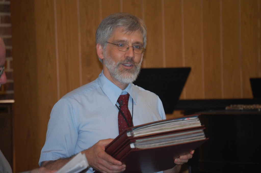 Joe Mitchell and the two scrap books of his 15 years at Salem United Methodist Church that were presented to him Sunday.