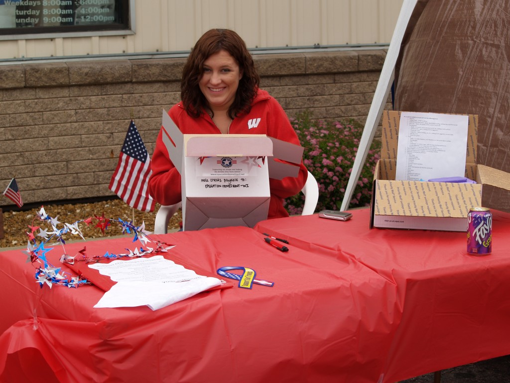 Sara Mikolajczak State Director of Programs-Operation Homefront reviews donations for Troop Care Packages