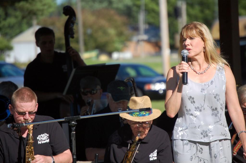 "Carole Crawford, lead vocalist, sings ""Sunny."""