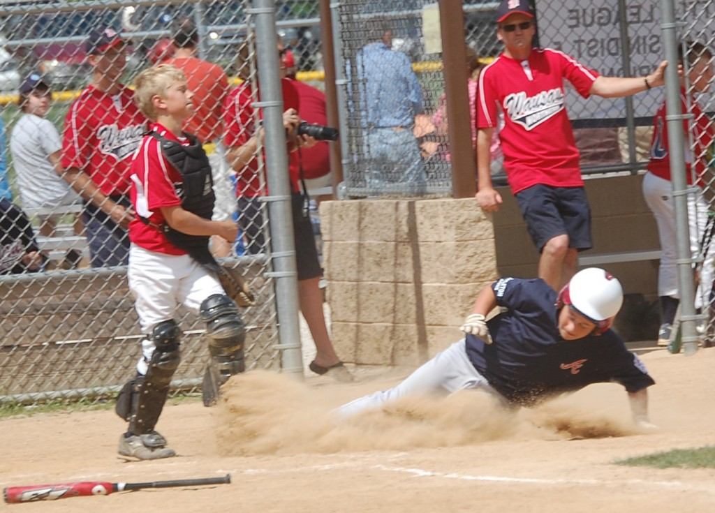 An Appleton batter slides in to score. Appleton beat Wausau 11 to 1.