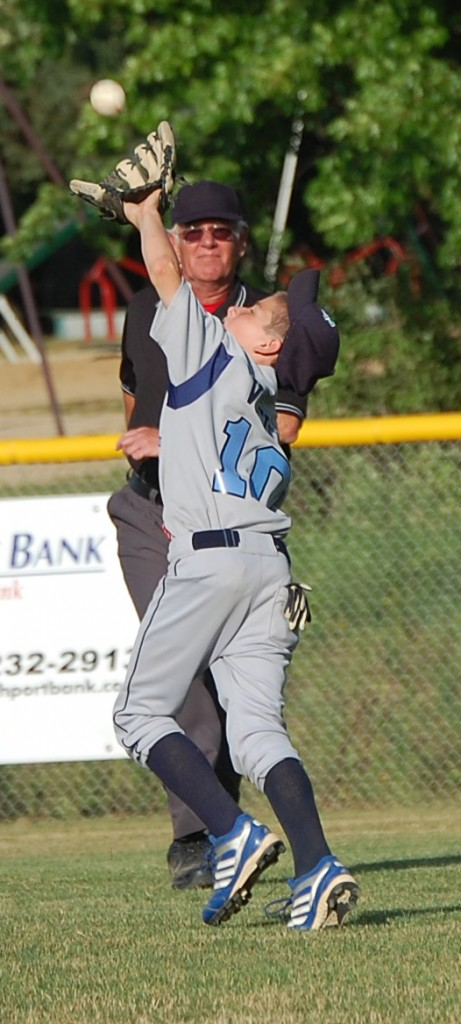 A Glendale outfielder gathers in a fly ball.