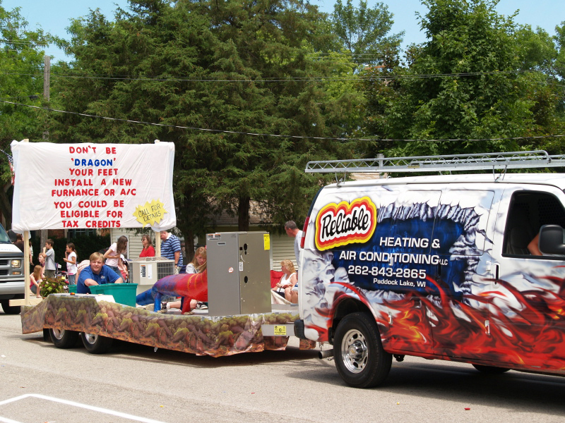 Reliable Heat and Air Conditioning had several of the company's vehicles in the parade plus a float.
