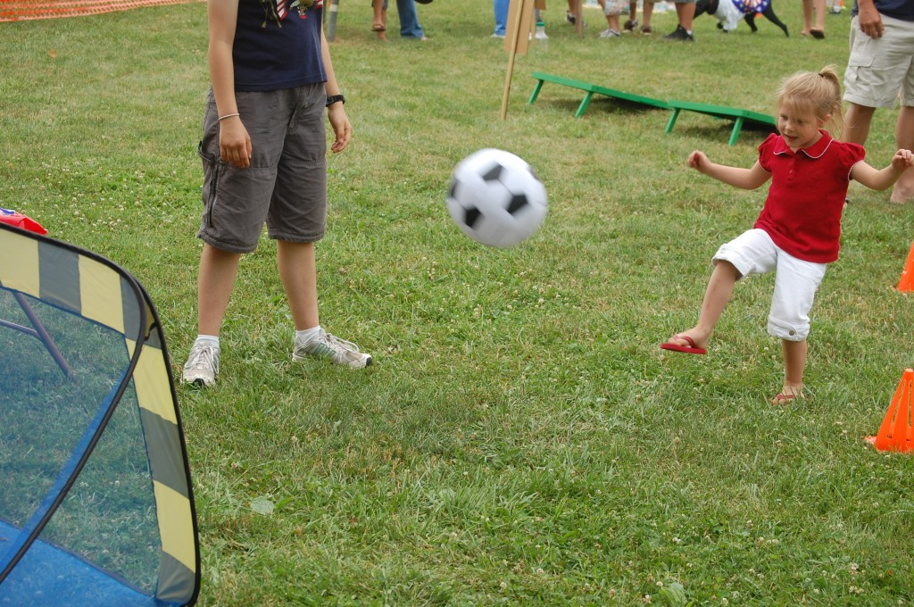 Syndie Bernier of Salem takes a kick at scoring in a soccer game. This year's festival included several children's activities in Schmalfeldt Park.