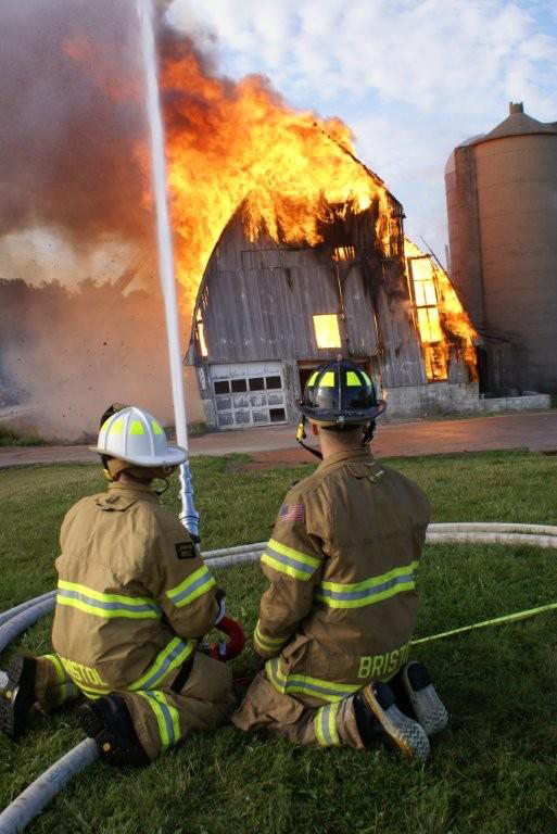 Bristol firefighters put water on the fire burning down a barn along Highway 50 as part of a training exercise Saturday./Bristol Fire Department photo by Jim Durkin