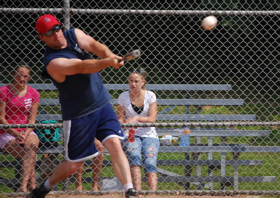 Assistant Fire Chief Al Stolp at bat. /Andrew Strother photo
