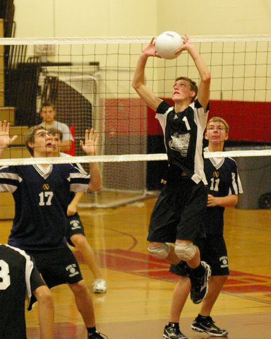 Dayton Erikson, 1, set ups a point for the Falcons./David Thoss photo