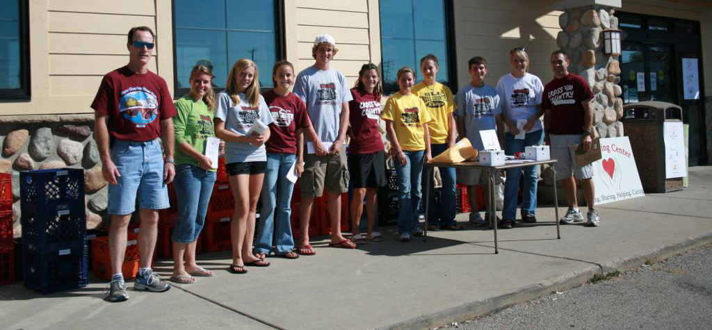 The Central cross county team with the food they collected in a food drive for The Sharing Center.