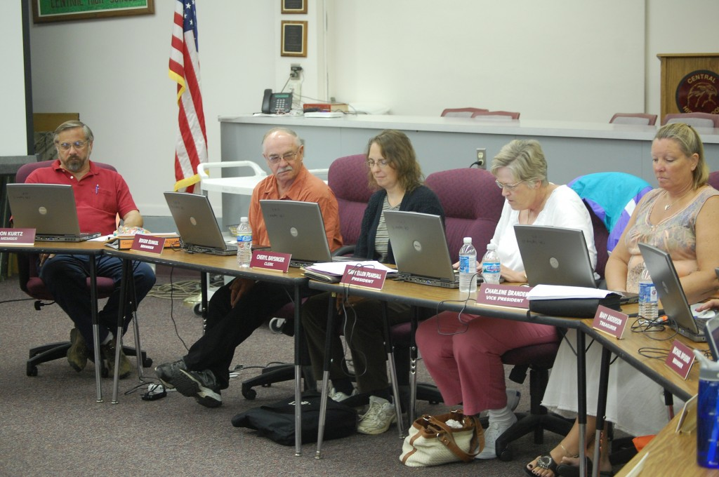 Central High School Board members used computers Tuesday for their meeting materials instead of paper. It was the first time the board had tried the paperless method.