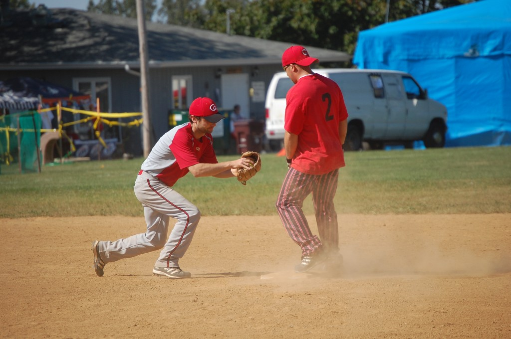 A runner from Al's beats the tag at second from a Red Dog player.