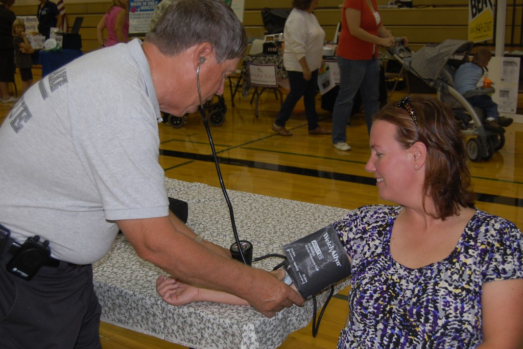 State Reop. Samantha Kerkman has her blood pressure checked by Silver Lake Rescue Squad member Bob Johnson.