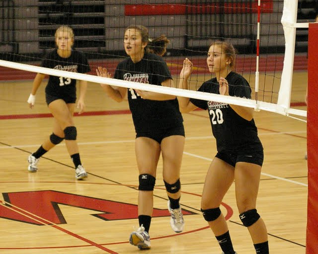 Lauren Hickson, Linda Flahive and Shelby Shumaker get ready to block a Wilmot attack.