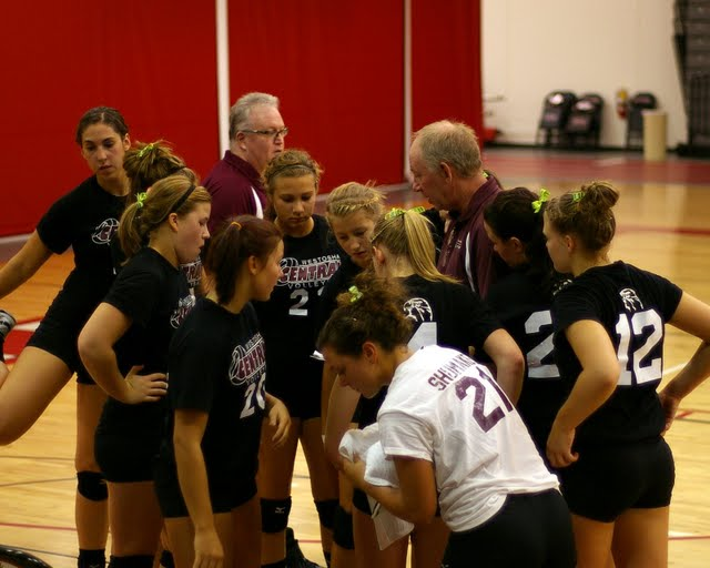 Central Coach Charlie Berg gives the last pregame instructions to the Falcons squad./David Thoss photo