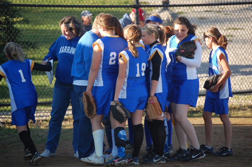 The Wheatland team huddles up between innings.