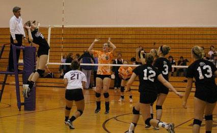 Lauren Ineichen goes up for kill vs Burlington./David Thoss photo