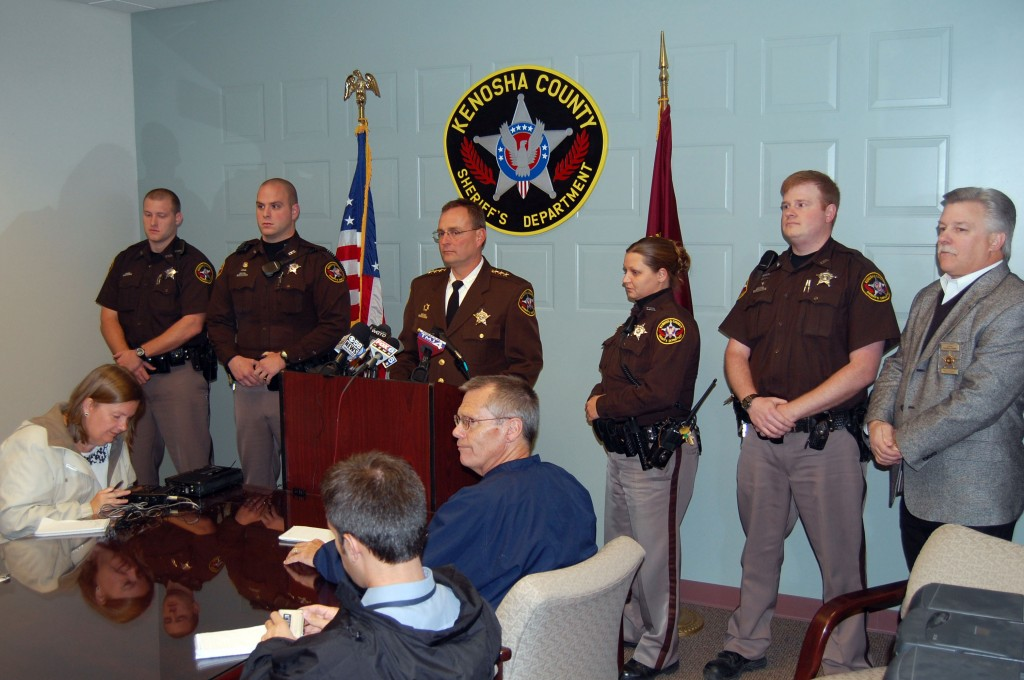Sheriff David Beth addresses the media at a press conference Wednesday monring concerning the killing of a Brighton man during a home invasion. Around Beth are other deputies who were involved in aprehending four suspects or investigating the crime so far.