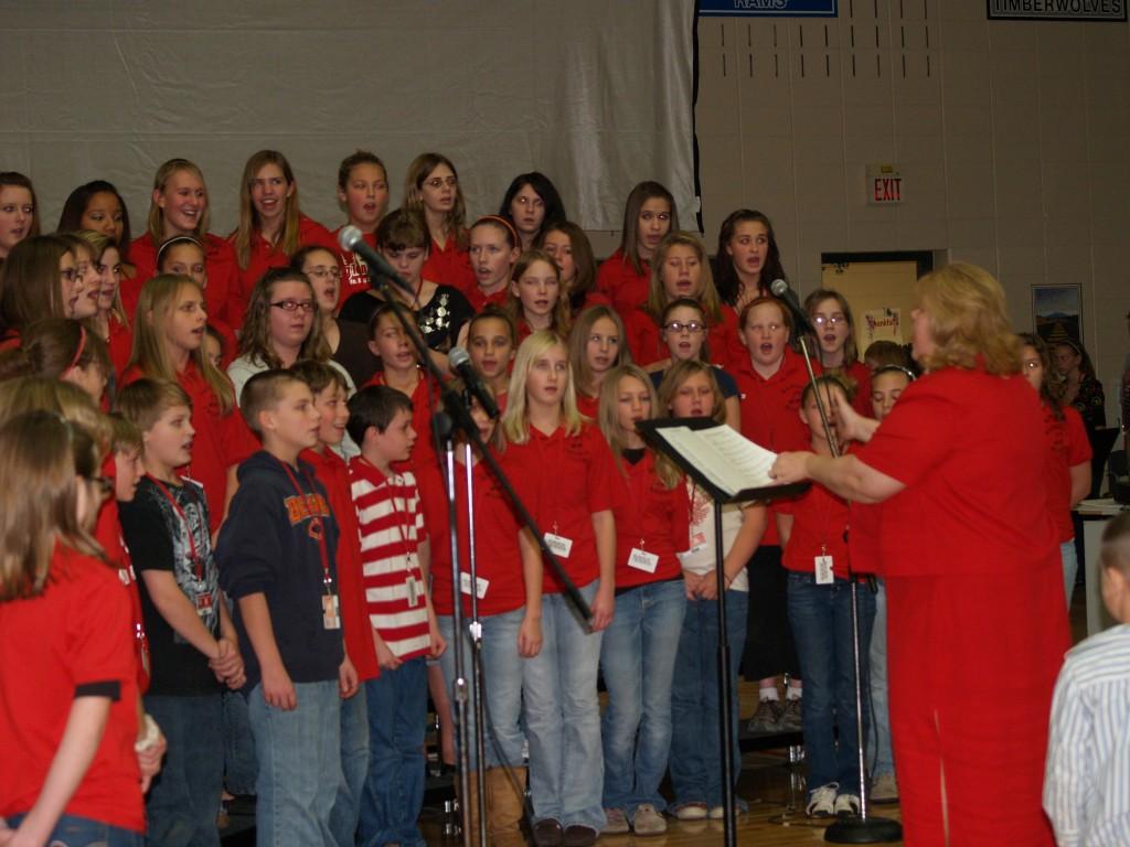 Choir singing patriotic songs to honor the veterans