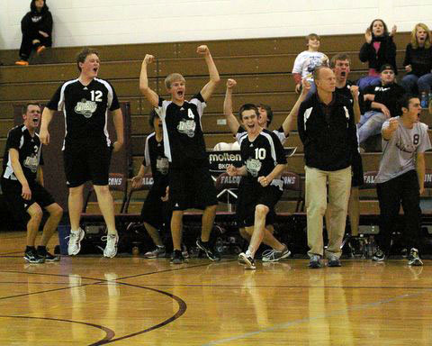 The Central bench erupts as the final point is scored .