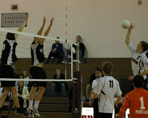 Scott Walter, left in black, and Jimmy Schultz, right, go up for a block