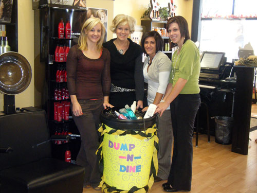 Bristol Hair Shoppe staff show-off the items they collected for donation to The Sharing Center. /Submitted photo