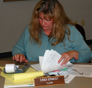 Salem Town Clerk Cindi Ernest recounts the number of electors signed in to vote Tuesday night.