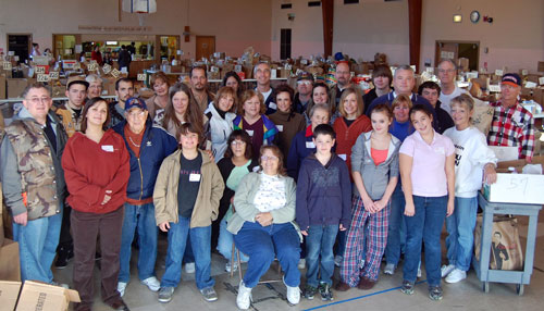 The volunteers that worked The Sharing Center's Thanksgiving meal distribution pause to pose for a group photo.