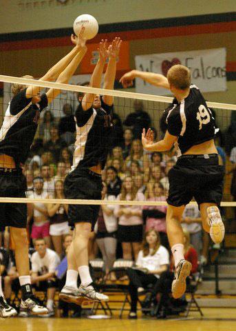 Jimmy Schultz goes high for a kill vs Middleton. /David Thoss photo