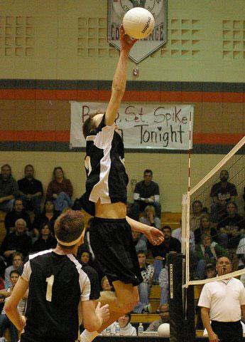 Senior Scott Walter goes for a point off a set by Dayton Erickson, 1. /David Thoss photo