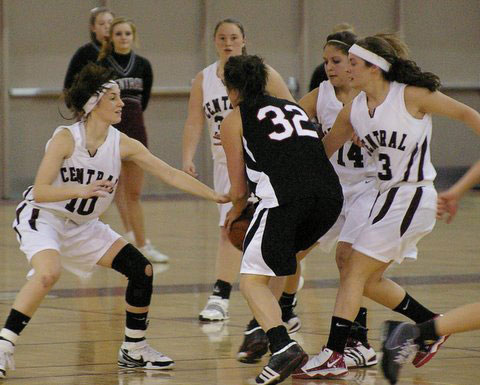 Central's Abbey Reeves, 10, Cassie Cox, 14 and Hayden Krueger collapse on Wilmot's Jackie Herman.